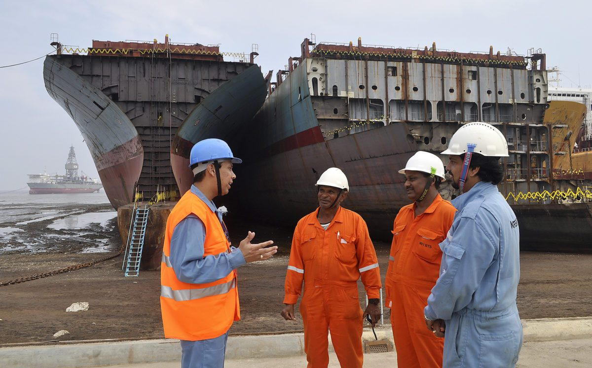 Maersk representatives and ship at the Shree Ram ship recycling yard in Alang, India. Photo: Maersk Line
