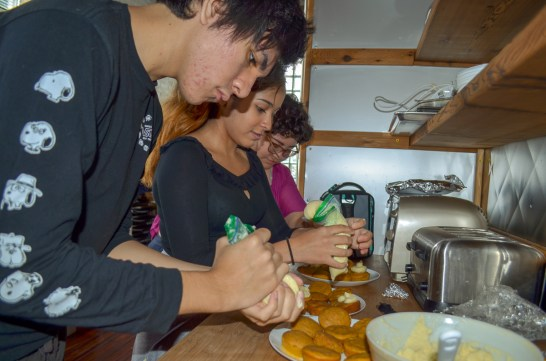 Frosting the cupcakes.