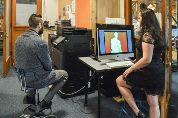 A GCE student performs a 3D scan.