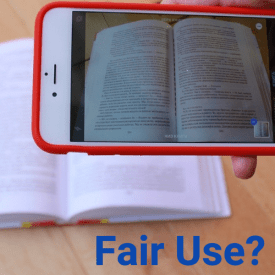"Photo of phone taking photo of text with question ""Fair Use?"" posed"