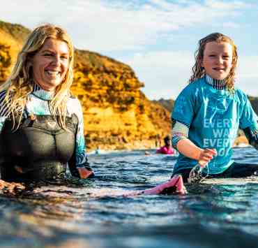 Stephanie Gilmore and Rising Tides participant taking in the water at Bells Beach