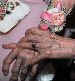 The couple show off their new wedding rings