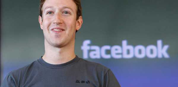 Mark Zuckerberg from Facebook smiling in a grey shirt