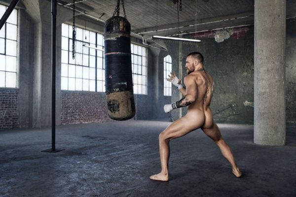 Conor McGregor in the Naked ESPN video punching a punching bag fully naked