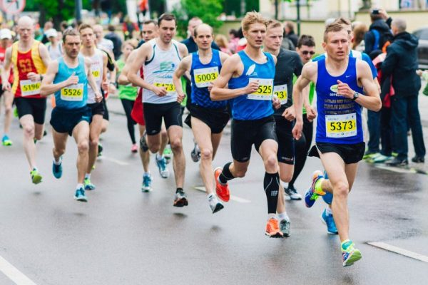 Man running in a marathon which is a metaphor for being in a gay long distance relationship