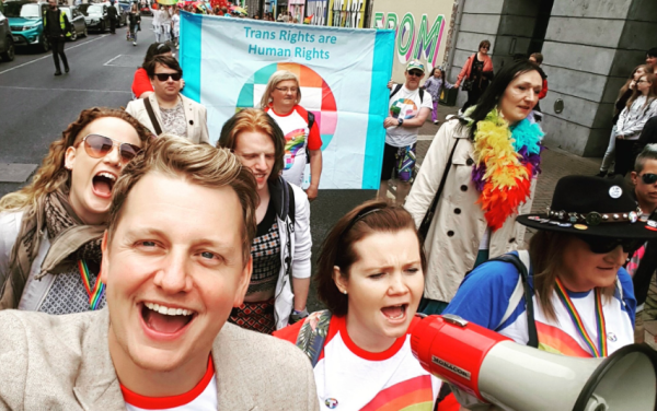 TENI staff marching in pride, TENI being one of the LGBT issues that Apple's €13b tax could help