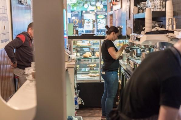 A barista in Aperitvo making coffee