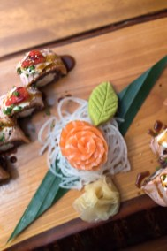 Close up of salmon on a sushi board from Yamamori Sushi, who's manager Graham Ryan we interviewed in this month's Amuse Bouche