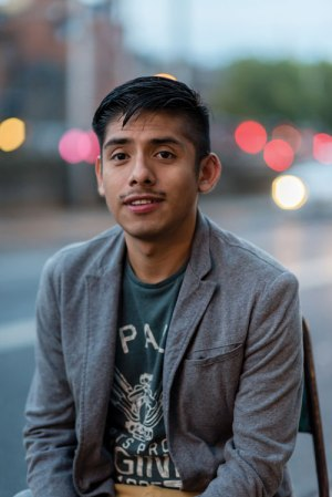 Javier (a gay man of colour) poses for a photo as he discusses racism in Ireland