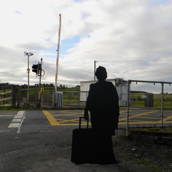 The silhouette of a woman with a suitcase as part of Will St Leger's Out of the shadows art project