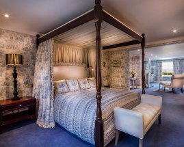 An interior shot of the lodge at ashford castle where if you book a wedding, you could win a luxury cruise to the value of e10000 with a four poster bed