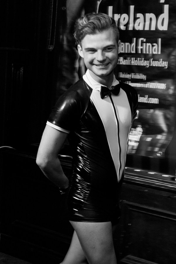 Stephen Lehane in a latex tux as the winner of Mr Gay Ireland 2017 in black and white
