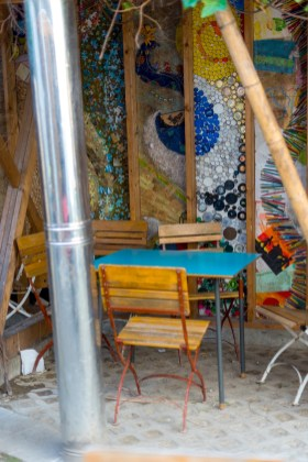 Wooden chairs and a painted wall in the outdoor seating area at the cake cafe and slice which are both owned by Ray O'Neill
