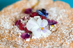 Gorgeous iced pancakes with fruit and flowers on top at the cake cafe and slice which are both owned by Ray O'Neill