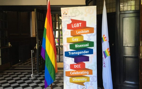 a rainbow flag and a poster saying LGBT lesbian gay bisexual transgender DCC Celebrating Diversity on coloured ribbon from the launch of the DCC LGBT Inclusion Strategy
