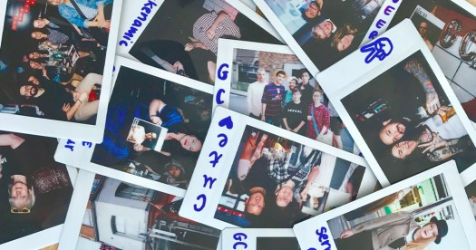 Some of the polaroids from the GCN relaunch party lain on top of each other