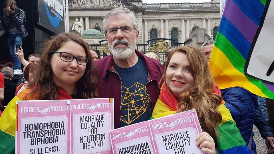 Sinn Fein's Gerry Adams hugs two young marchers