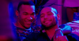 A gay couple smiling in red and blue light from the PrEP Project videos