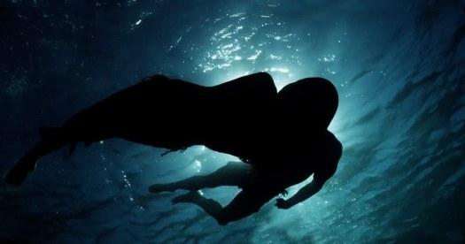 A scene from the new fifty shades trailer showing two silhouettes underneath water