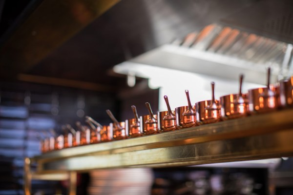 The Tomahawk steakhouse kitchen with mini saucepans for sauces
