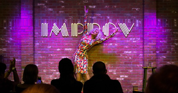 Panti doing a stretch on stage at the Hollywood Improv