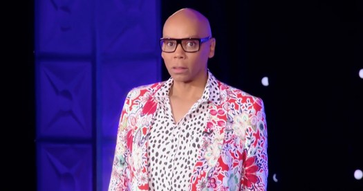 RuPaul standing in a bright white and red suit to promote RuPaul's Drag Race All Stars 3