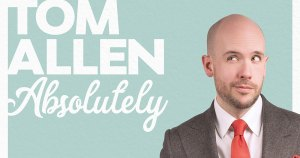 Tom Allen absolutely in a suit with a red tie