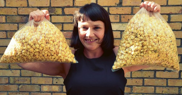 Ruth Ormiston from Cornude holding two bags of popcorn