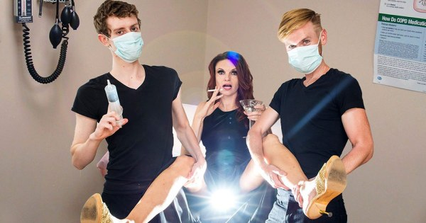Jackie Monahan, the star of Codependent Lesbian Space Alien Seeks Same in stirrups with two doctors either side of her wearing face masks and a bright light emanating from her legs.