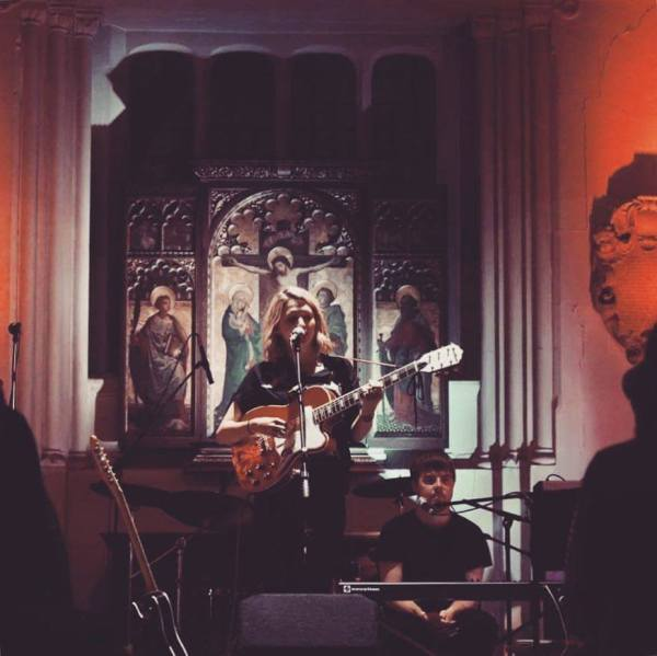 Image of Ailbhe Reddy perfoming in headline show at St Pancras Old Church in London