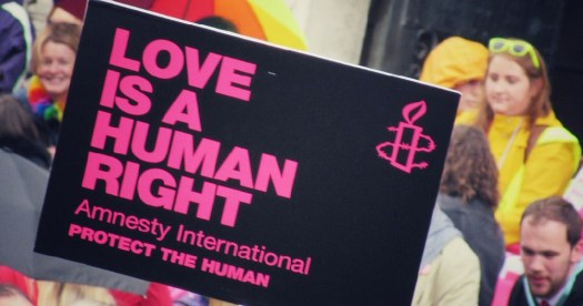 """Protest following failed talks Amnesty International sign reads """"Love is a human right"""""""