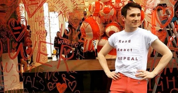 Richard Malone stands outside his Repeal Campaign Piece in the window of Selfridges