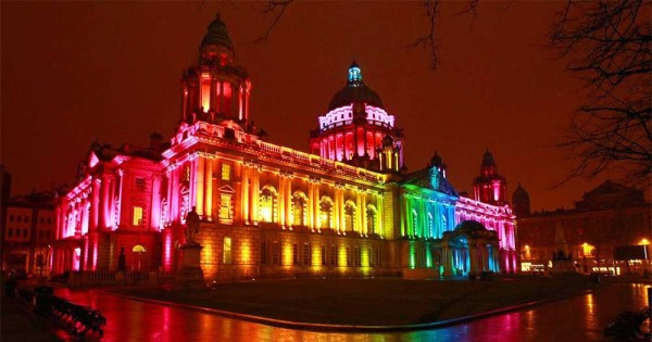 Belfast city hall lit up in rainbow colours to highlight latest poll suggesting support for gay marriage