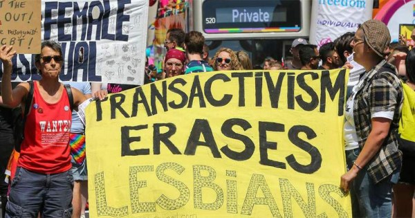A lesbian group at the head of the London Pride parade decrying what they refer to as the trans agenda by holding a banner reading 'trans-activism erases lesbians'.