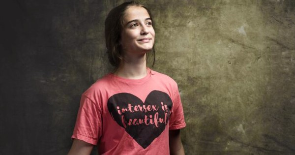 """Intersex person wearing a t-shirt that reads """"intersex is beautiful"""""""