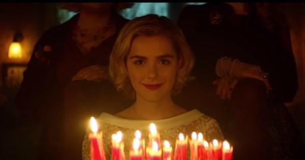 Image of Kiernan Shipka blowing out candles in Sabrina remake.