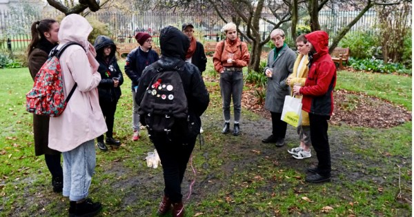 Students at gather at Trinity College to mourn lives lost to transphobic violence.
