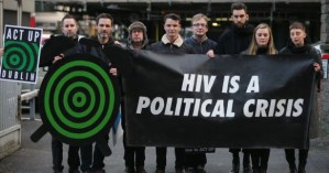 """Activists from ACT UP hold up a banner that reads """"HIV is a Political Crisis"""" as they address the HIV crisis in Ireland."""