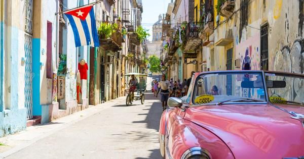 Cuba flag flown of a building on a street in Havana