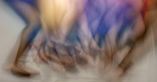 A picture of different people's legs tangled at an after party