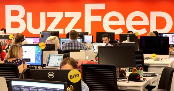 BuzzFeed offices where people are working in front of a big BuzzFeed sign.