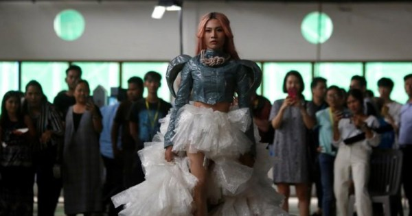A model wears plastic couture