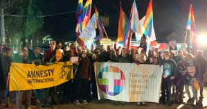 LGBT community supporting Chechnya hold banners and rainbow flags outside the Russian Embassy
