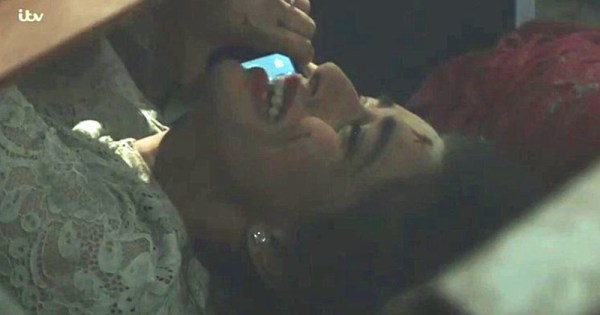 Character of Rana on the phone to Kate while trapped beneath the rubble