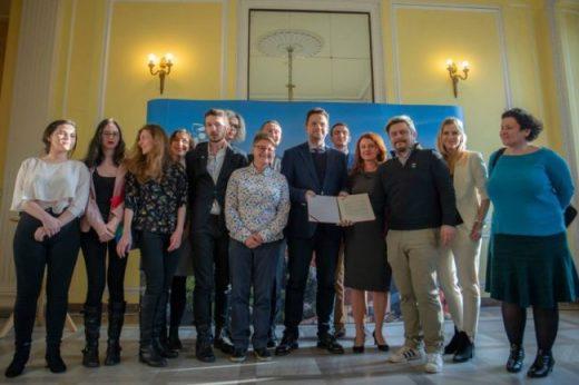Mayor Trzaskowski and local LGBT+ advocates stand together against Warsaw homophobes