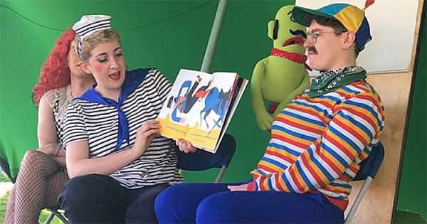 Glitter Hole performing Drag Story Time