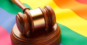 A gavel on a rainbow flag, celebrating the victory in a Russian court