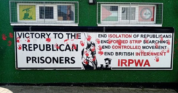 Protesters marked the wall of this dissident republican office with red handprints to protest the murder of Lyra McKee
