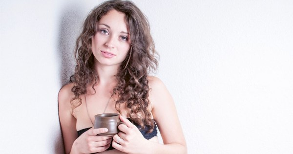 Promo for Revolting Women at the International Dublin Gay Theatre Festival featuring a young woman leaning against a wall holding a coffee cup