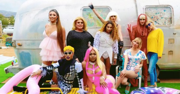 taylor swift stands with 5 drag queens in front of vintage trailer